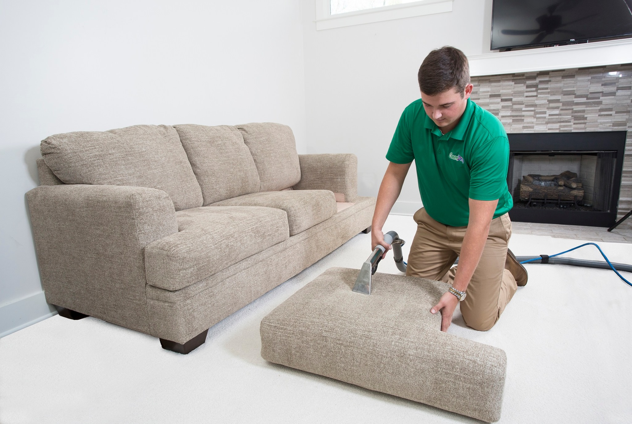 Chem-Dry technician cleaning a couch cushion